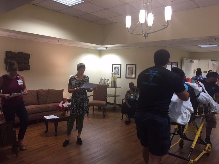 Residents of the Sentara Nursing Center in Currituck, North Carolina, arrive at an affiliated nursing center in Portsmouth, V