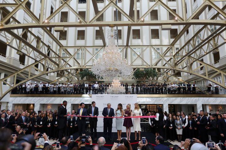 The Trump family cutsthe ribbon on the Washington hotel in October 2016.