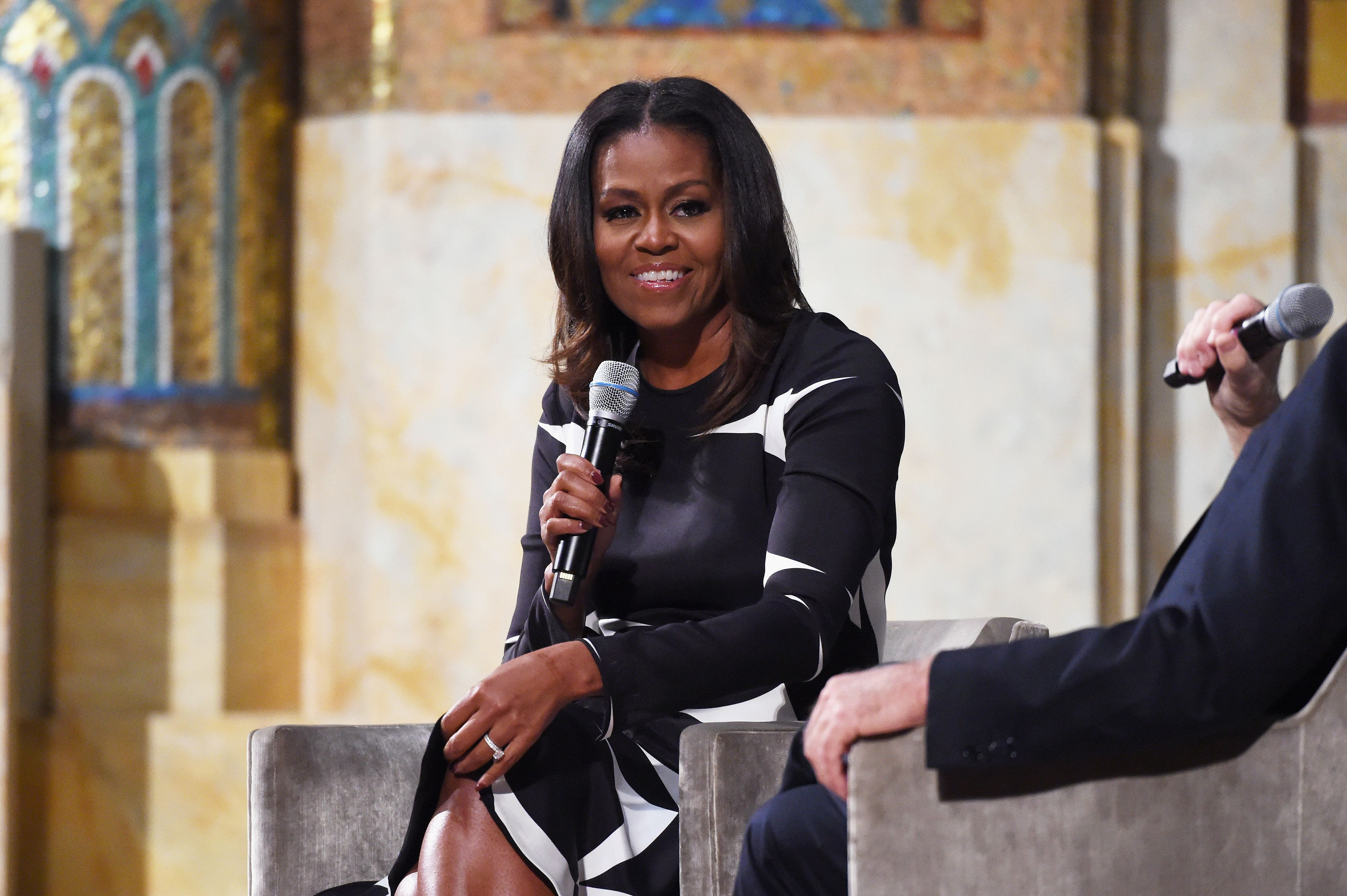NEW YORK, NY - OCTOBER 25:  Michelle Obama (L) and David Letterman speak onstage as The Streicker Center hosts a Special Evening with Former First Lady Michelle Obama at The Streicker Center on October 25, 2017 in New York City.  (Photo by Michael Kovac/Getty Images)