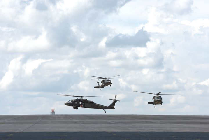 Three North Carolina Army National Guard Black Hawk helicopters land as part of storm preparation for Hurricane Florence at t