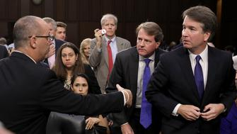 WASHINGTON, DC - SEPTEMBER 04: Fred Guttenberg (L), father of murdered Marjory Stoneman Douglas High School student Jamie Guttenberg, tries to shake the hand of Supreme Court nominee Judge Brett Kavanaugh as Kavanaugh appeared before the Senate Judiciary Committee during his Supreme Court confirmation hearing in the Hart Senate Office Building on Capitol Hill September 4, 2018 in Washington, DC. Kavanaugh was nominated by President Donald Trump to fill the vacancy on the court left by retiring Associate Justice Anthony Kennedy.  (Photo by Chip Somodevilla/Getty Images)