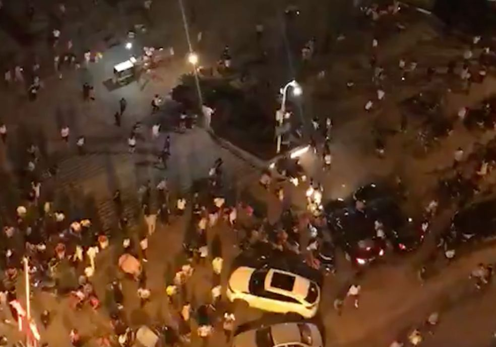 Screengrab shows people fleeing a pedestrian area in the Chinese city of Hengyang in Hunan province after a driver plowed a vehicle into the crowded square.