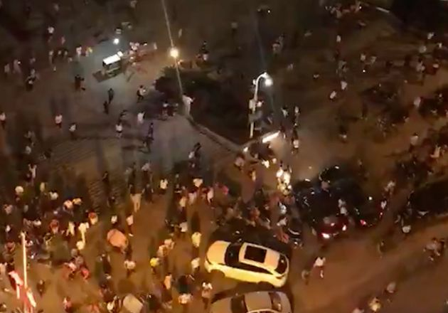 Screengrab shows people fleeing a pedestrian area in the Chinese city of Hengyang in Hunan province after...