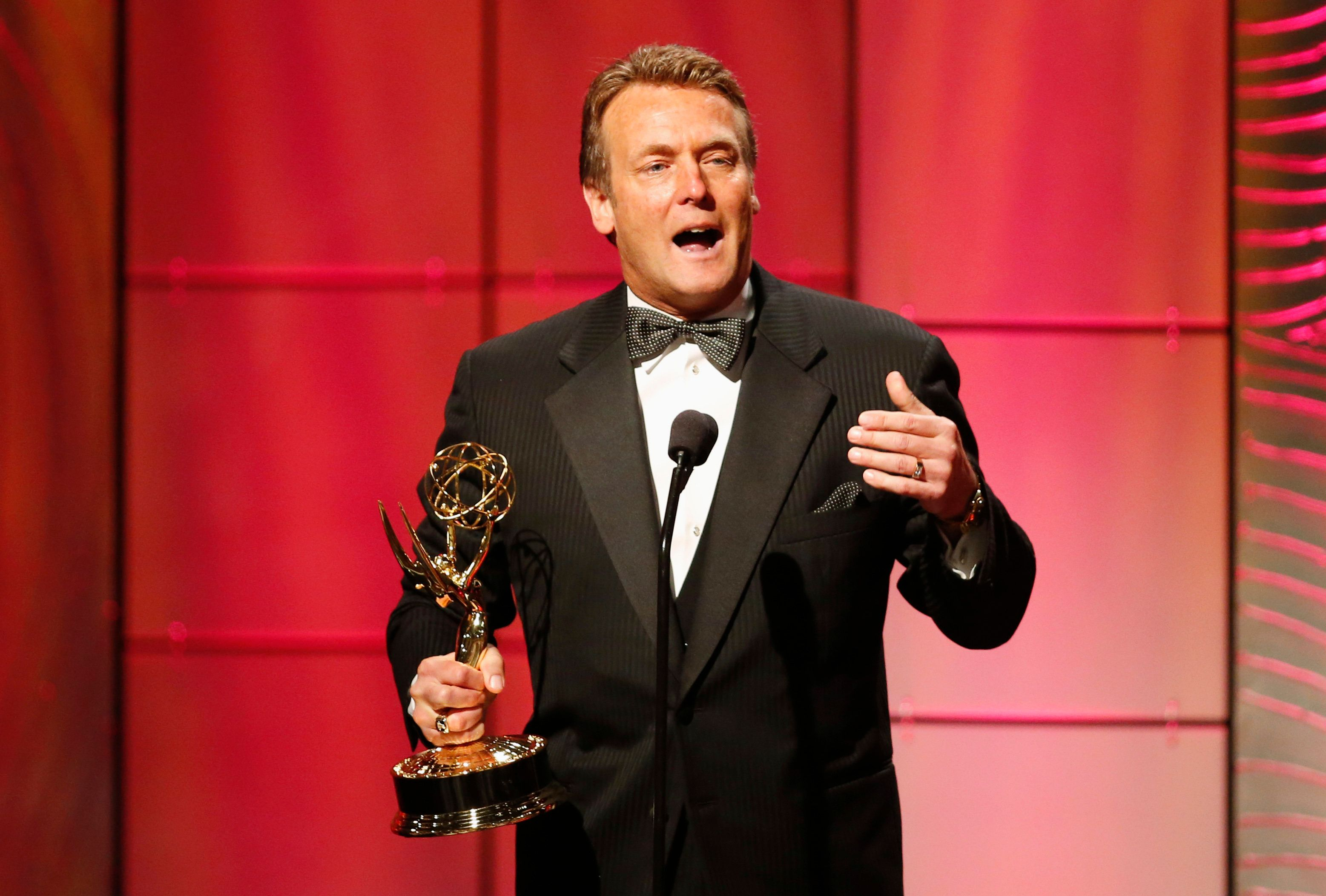 "Doug Davidson of ""The Young and the Restless"" accepts his outstanding lead actor in a drama series award during the 40th annual Daytime Emmy Awards in Beverly Hills, California June 16, 2013. REUTERS/Danny Moloshok (UNITED STATES - Tags: ENTERTAINMENT)"