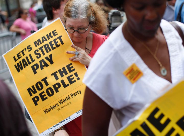 Activists near Wall Street in New York City in August 2011 protest the massive budget cuts being proposed in the debt-ceiling