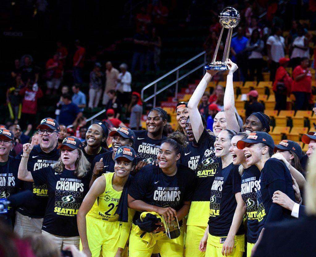 Seattle Storm forward Breanna Stewart holds and poses with the trophy with her teammates after Game 3 of the WNBA basketball finals against the Washington Mystics, Wednesday, Sept. 12, 2018, in Fairfax, Va. The Storm won 98-82 and the title. (AP Photo/Nick Wass)