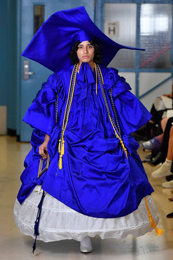 According to the Vaquera show, which took place on Sept. 11, mortarboards (a.k.a. graduation caps) of epic proportions are an