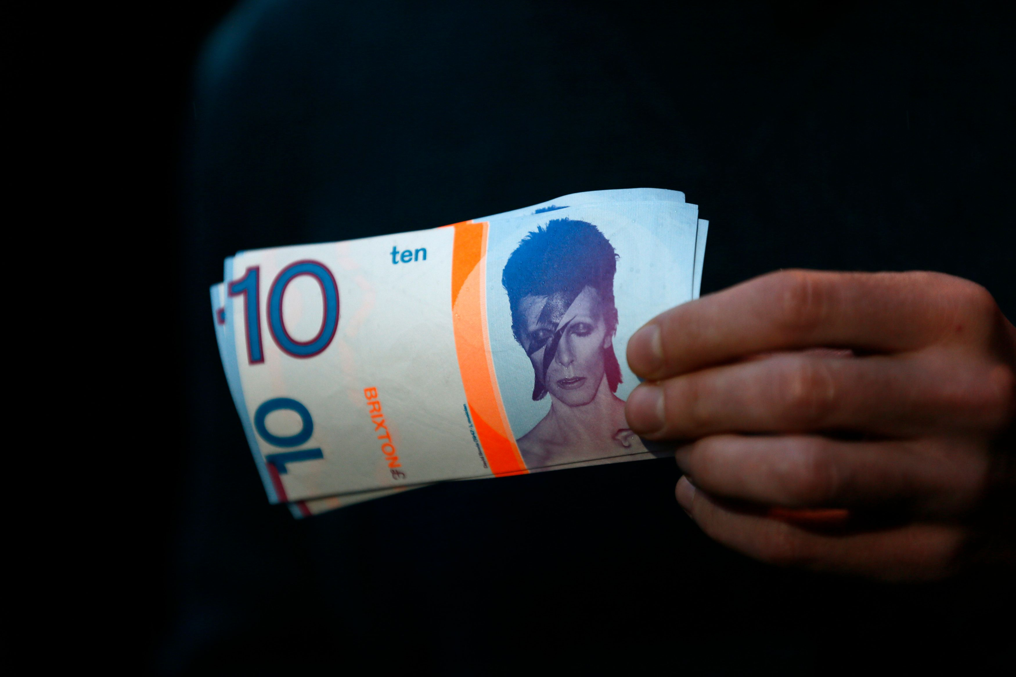 A note worth 10 Brixton pounds, an alternative currency in London, is illustrated with an image of David Bowie.