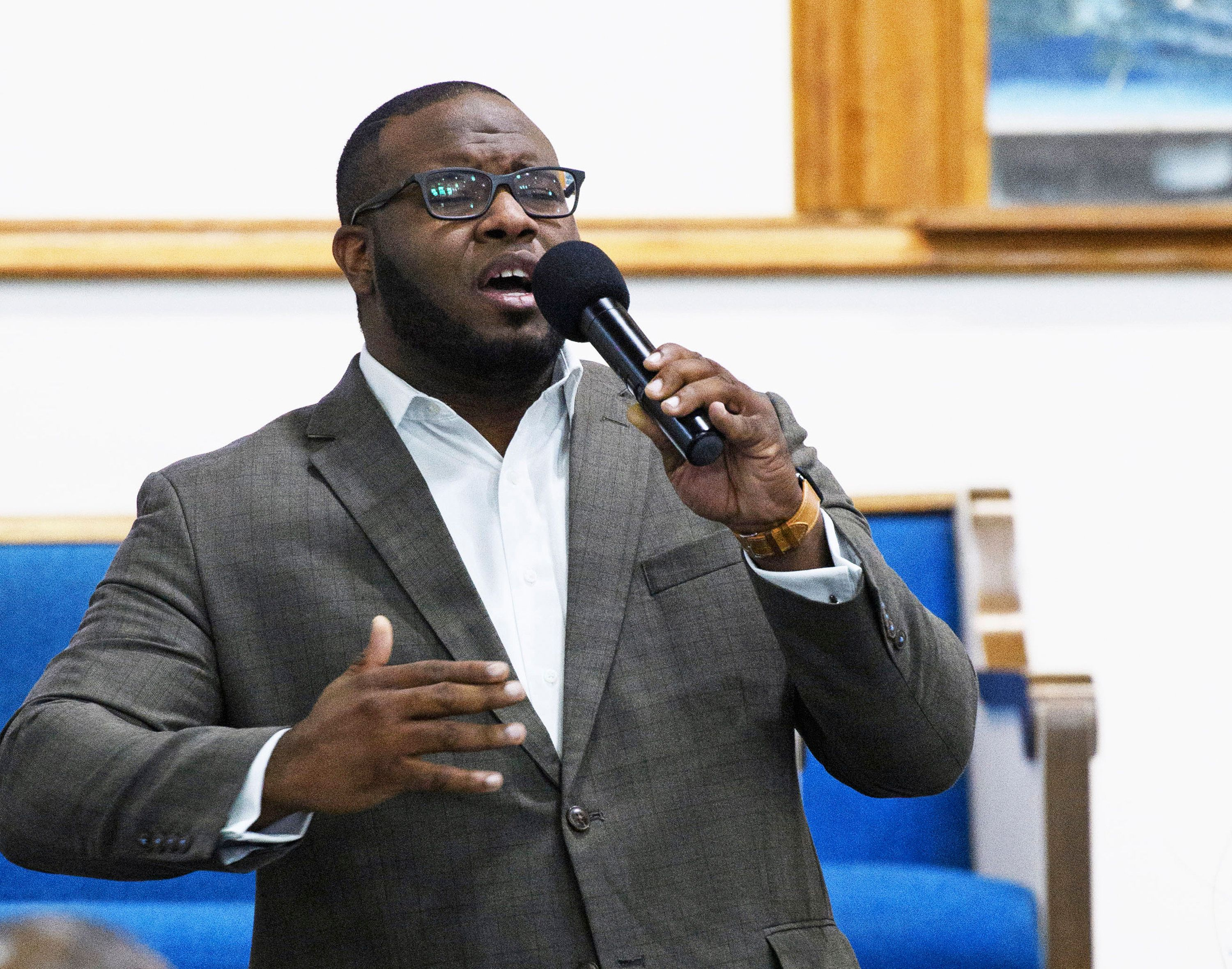 Botham Shem Jean leads worship at a Harding University reception in Dallas in 2017.