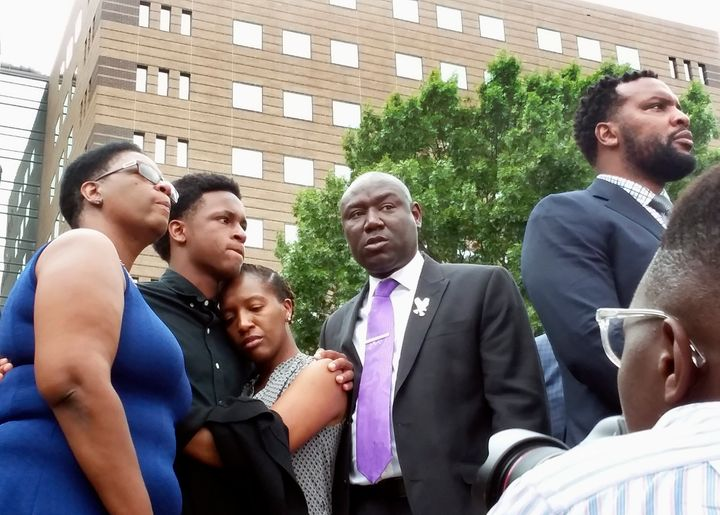 Allison Jean (far left), mother of Botham Shem Jean, stands alongside his brother and sister, as well as family attorneys Ben