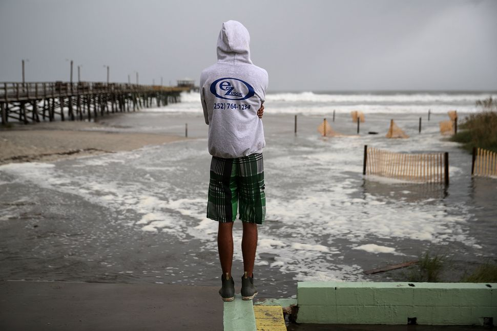 Water rolls up Atlantic Beach as the outer edges of Hurricane Florence begin to affect the coast on Sept. 13, 2018.