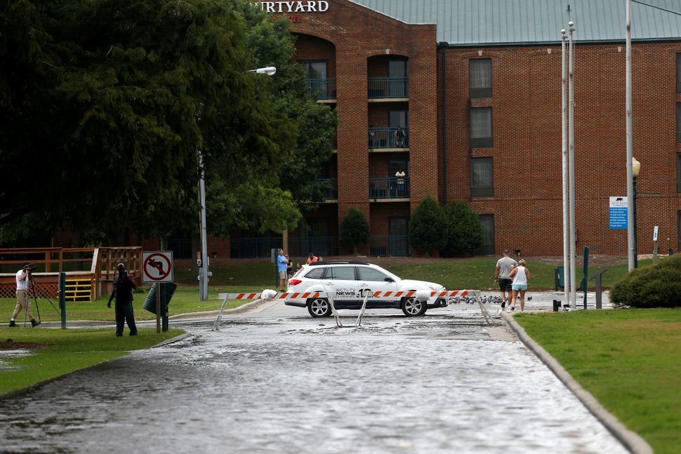 Heavy rain floods a street as the outer bands of Hurricane Florence hit New Bern, North Carolina, on Sept. 13, 2018.