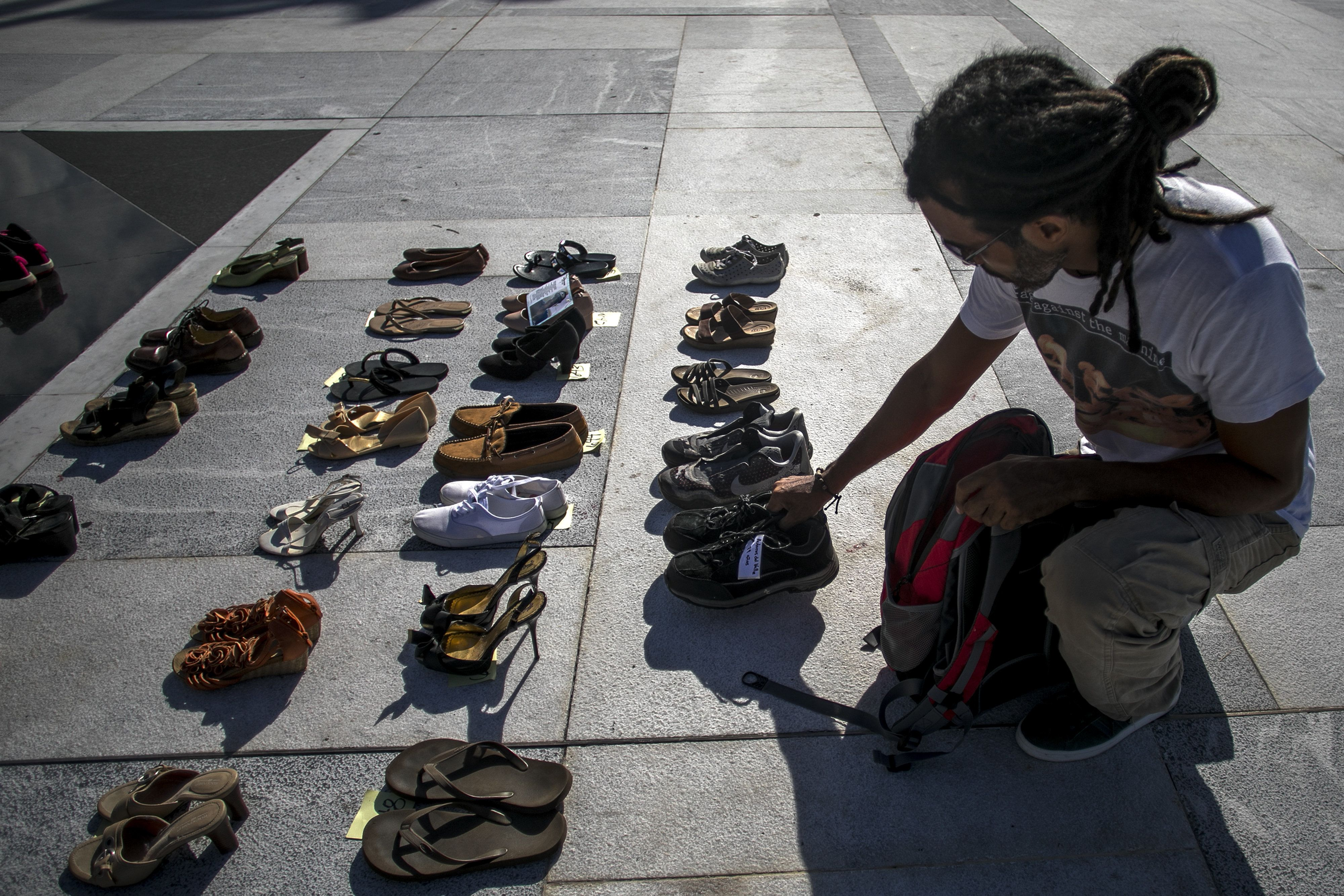 A demonstrator places an empty pair of shoes on display outside the Capitol building during a protest against the government's reporting of the death toll from  Hurricane Maria in San Juan, Puerto Rico, on Friday, June 1, 2018. Hurricane Maria probably killed about 5,000 people in Puerto Rico last year even though the official count remains at just 64, according to a Harvard University study released Tuesday. Photographer: Xavier Garcia/Bloomberg via Getty Images