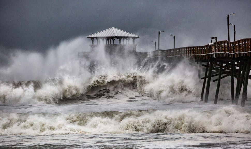 Waves slam the Oceana Pier and Pier House Restaurant in Atlantic Beach, North Carolina, on Sept. 13, 2018.