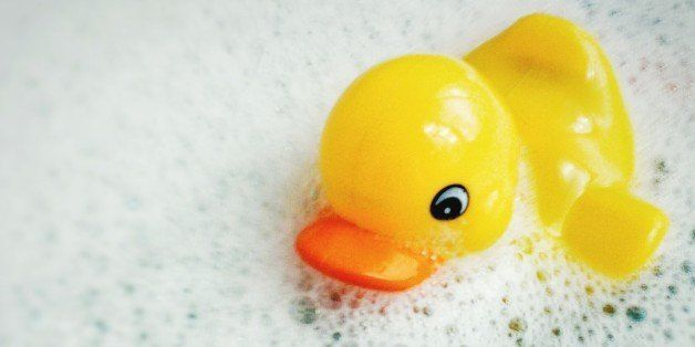 Close-Up Of Rubber Duck Floating On Bathtub