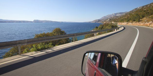 Drivers view of road and coast driving down the Croatian coast