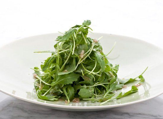 Along with a classic Dijon vinaigrette, this arugula salad benefits from the addition of nuts, which add texture and crunch t
