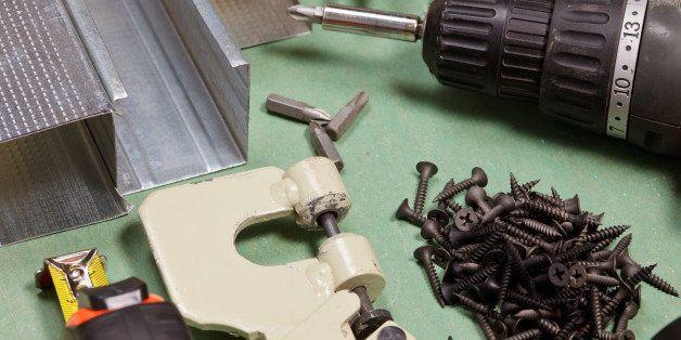 Plasterboard tools set with metal studs, screws, tape measure, rasp, screwgun and punch lock crimper