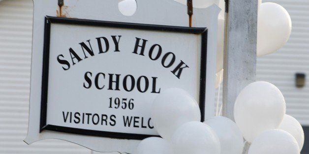 Balloons hang on a sign at the entrance to Sandy Hook School on December 15, 2012 in Newtown, Connecticut. The residents of an idyllic Connecticut town were reeling in horror from the massacre of 20 small children and six adults in one of the worst school shootings in US history. The heavily armed gunman shot dead 18 children inside Sandy Hook Elementary School, said Connecticut State Police spokesman Lieutenant Paul Vance. Two more died of their wounds in hospital.     AFP PHOTO/DON EMMERT        (Photo credit should read DON EMMERT/AFP/Getty Images)