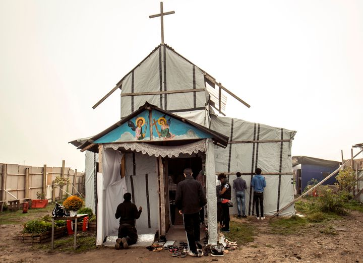 Ethiopian Coptic migrants arrive for a Mass at the makeshift Orthodox church in a migrant camp in Calais, northern France,&nb