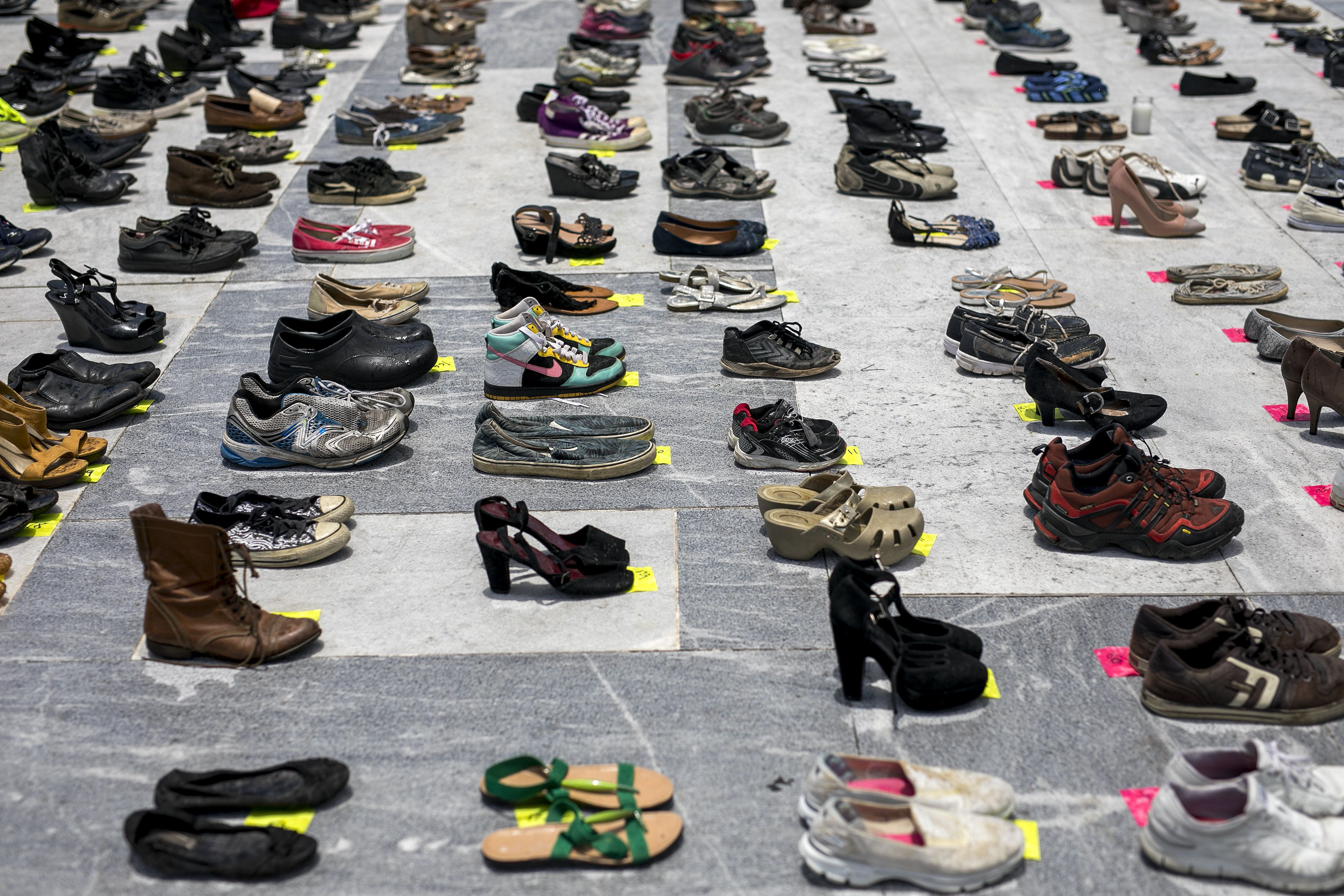 Empty pairs of shoes sit outside the Capitol building during a protest against the government's reporting of the death toll from  Hurricane Maria in San Juan, Puerto Rico, on Friday, June 1, 2018. Hurricane Maria probably killed about 5,000 people in Puerto Rico last year even though the official count remains at just 64, according to a Harvard University study released Tuesday. Photographer: Xavier Garcia/Bloomberg via Getty Images