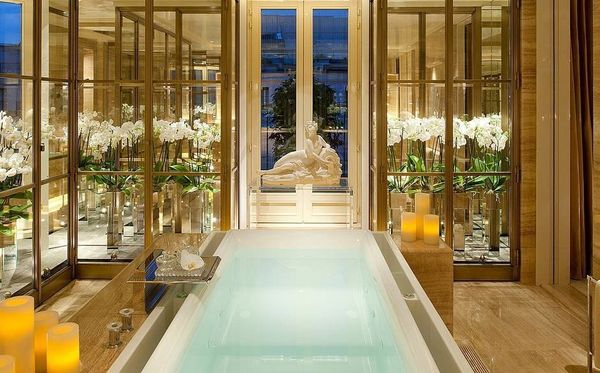 "A haven of marble, glass and gold, the bathroom in the <a href=""http://www.fourseasons.com/paris/accommodations/suites/the_pe"