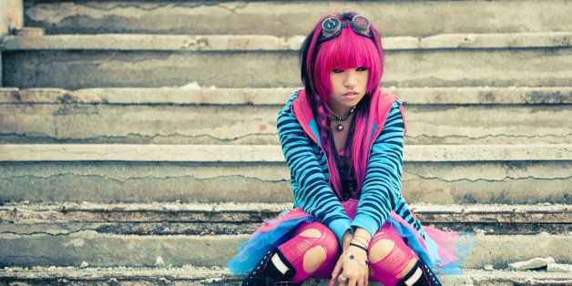 young asian sad girl with...