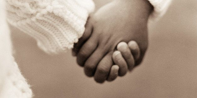 Two young children holding hands