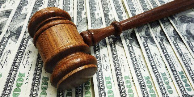 Judges court gavel on money