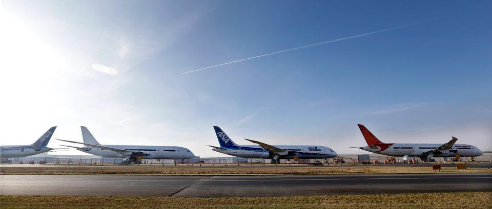 A line of 787 jets are seen parked nose-to-tail Thursday, Jan. 17, 2013, at Paine Field in Everett, Wash. Federal officials s