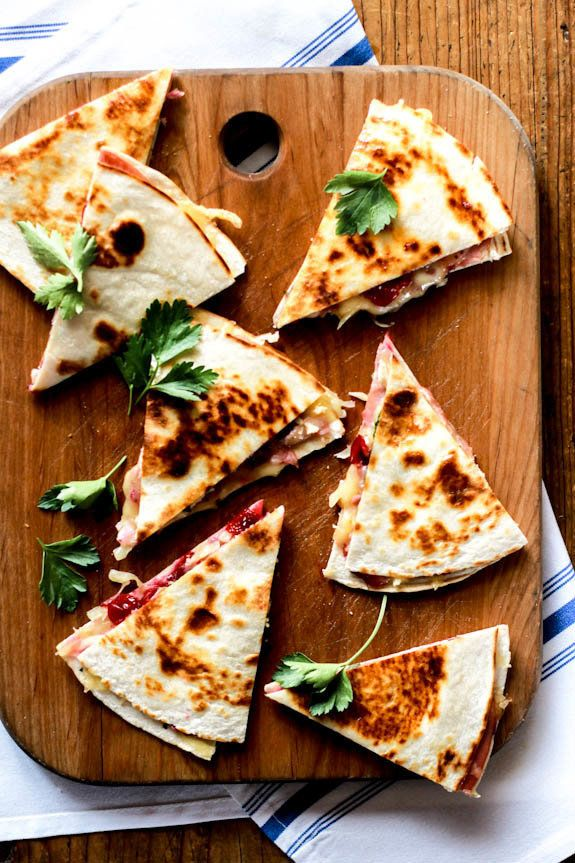 """<strong>Get the <a href=""""http://www.theclevercarrot.com/2013/11/turkey-cranberry-quesadillas-with-ham-brie/"""" target=""""_blank"""">"""