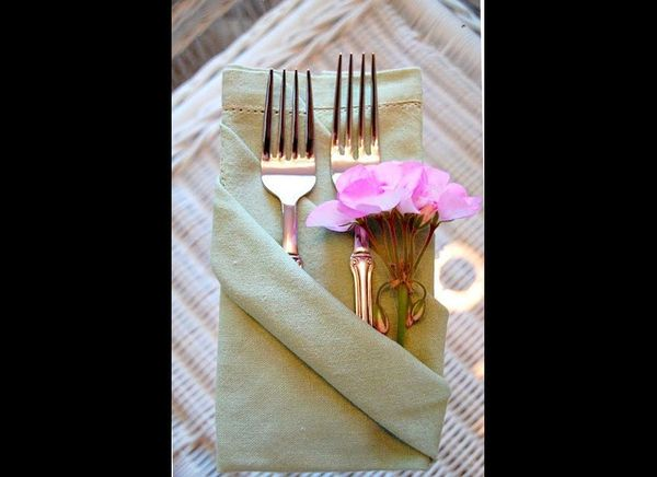 "This idea also gives you a place to put all those forks and flowers. Visit <a href=""http://betweennapsontheporch.net/napkin-f"