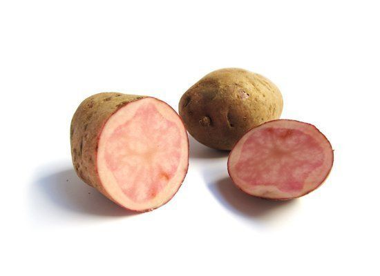 Adirondack Red potatoes have red skin with pink to red flesh that's either opaque or in a starburst pattern. Their color fade