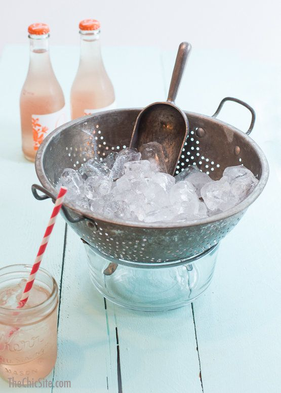 Fill a colander with ice, place it over a bowl and don't worry about your drink buckets being full of melted ice long after t