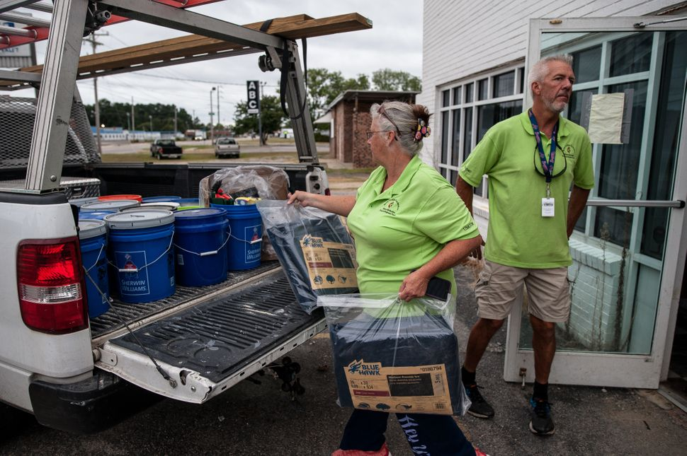 Anne and Jeff Wade loaded their pickup with supplies early Thursday in Lumberton.