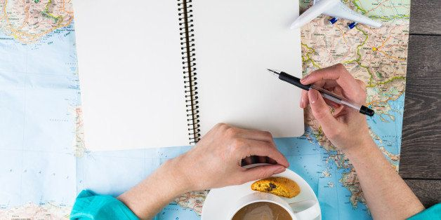 The woman blogger writing reviews about places visited in the trip. Planning travel. Thirst travel