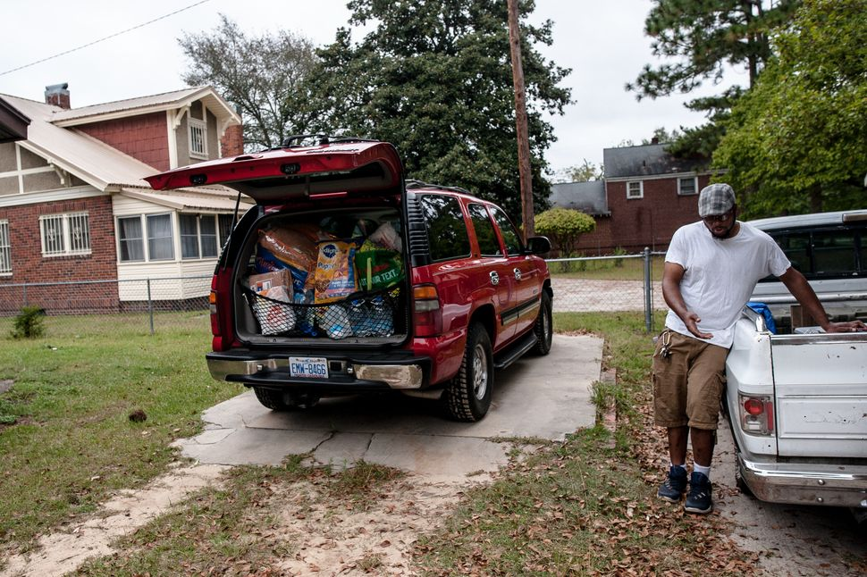 Matthew Peterson has his SUV packed and was loading up his pickup as his family prepared to evacuate their home in Lumberton,