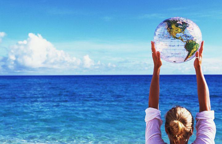 Woman holding globe beach ball