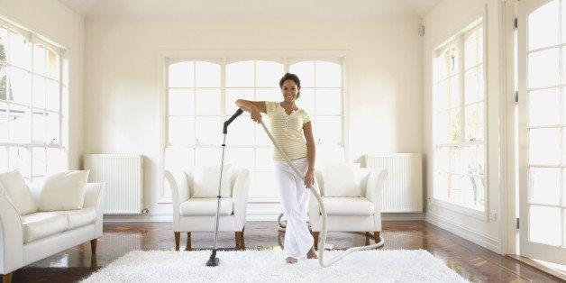 Hispanic woman vacuuming floor