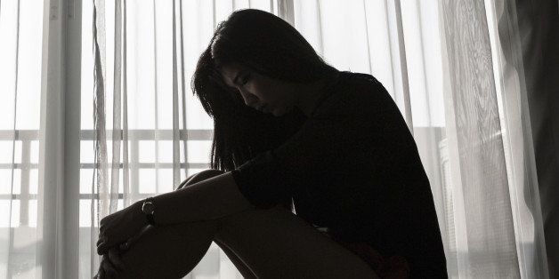 sad woman sitting alone