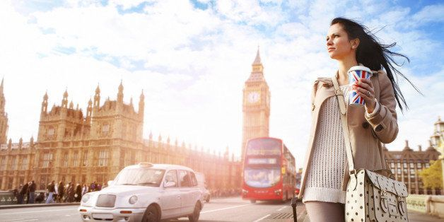 Female tourist walking with luggage at Big Ben in London. See my other photos from London:  http://www.oc-photo.net/FTP/icons/london.jpg