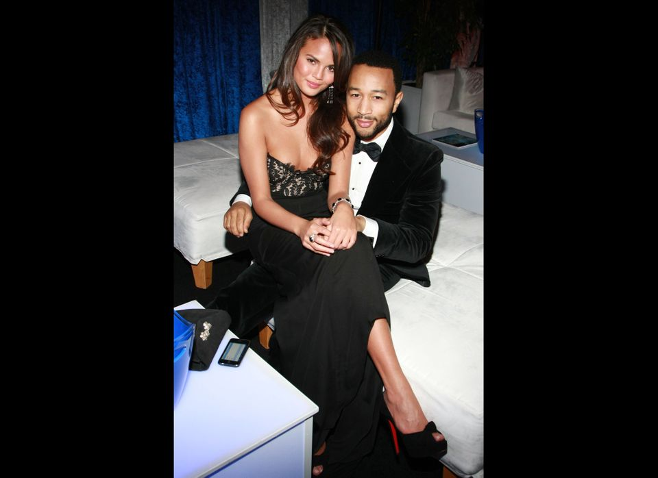 LOS ANGELES, CA - FEBRUARY 26:  Singer John Legend (R) and model Christine Teigen with Ciroc during the 41st NAACP Image awar