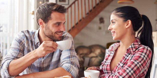 Couple meeting in a cafe ejoying a coffee together