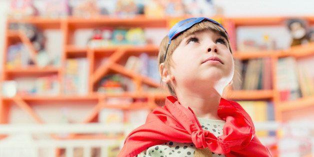 indoors, bookshop, library, play, props, portrait, kid, standing, messy, colourful, gender blending, dressing up, fun, mask, super hero, cape, knot, looking up, serious, daydreaming,