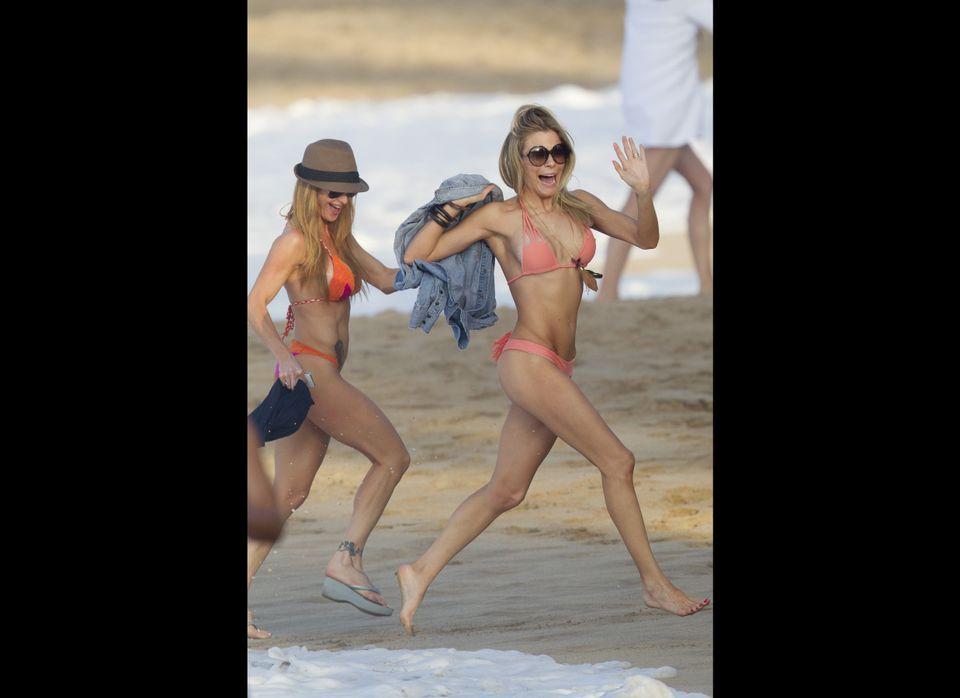 LeAnn Rimes gets playful, dodging the surf.  (Splash)