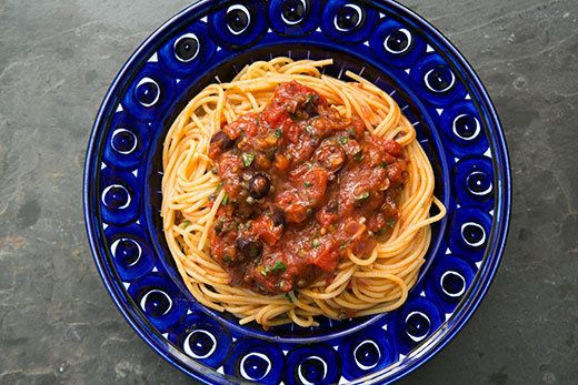 "<strong>Get the <a href=""http://www.simplyrecipes.com/recipes/pasta_puttanesca/"" target=""_blank"">Pasta Puttanesca</a> recipe"