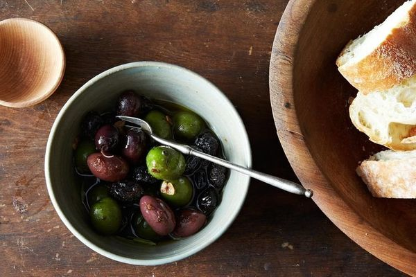 "<strong>Get the <a href=""http://food52.com/recipes/26770-warm-olives-in-anchovy-oil"" target=""_blank"">Warm Olives in Anchovy O"