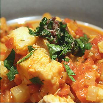 "<strong>Get the <a href=""http://www.cooksister.com/2008/07/tomato-saffron-fish-stew-with-anchovy-pesto-for-those-in-need-of-c"