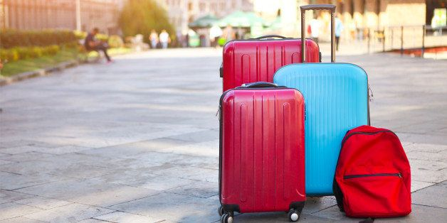 Luggage consisting of three large suitcases and travel backpack on the street. Holiday and travel concept