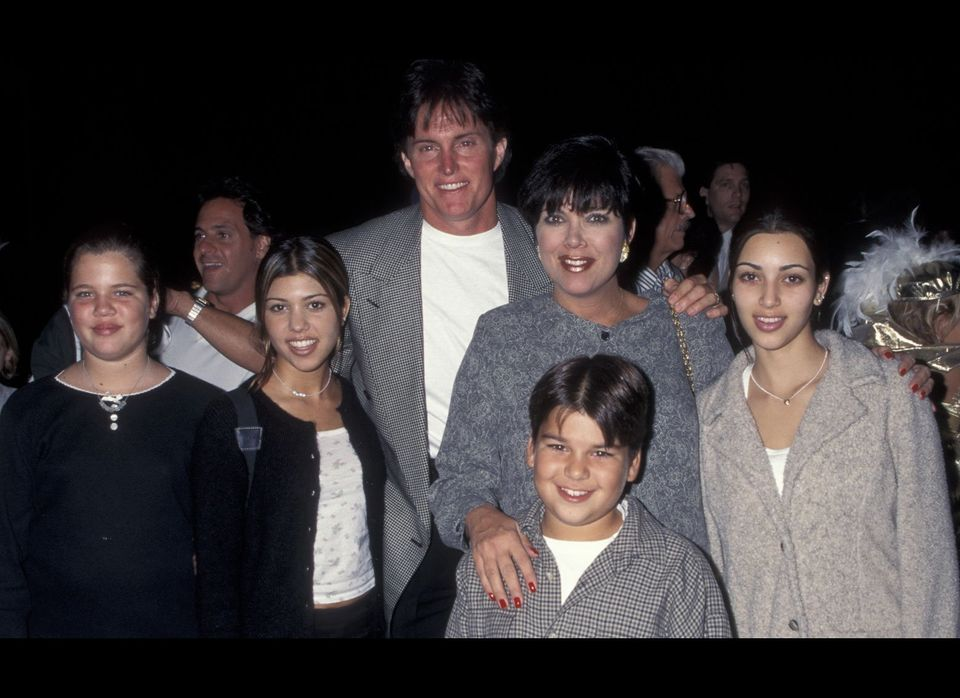 "A fresh-faced, 14-year-old Kim attends the ""Cinderella"" video release event with her mother, Kris, stepfather, Bruce, and sib"